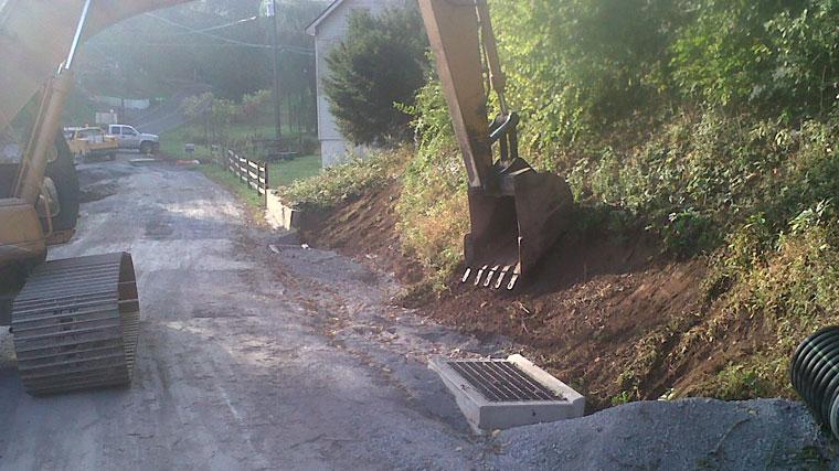 stone road with excavator